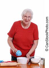 elderly woman baking