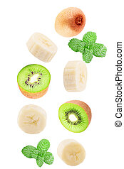 Falling sliced banana with kiwi and mint leaf isolated on white