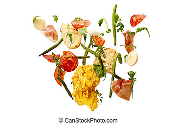 falling vegetables. Slices of tomato, eggs, asparagus, arugula, salami, prosciutto and toast. fresh salad ingredients in the air isolated on white background with clipping path