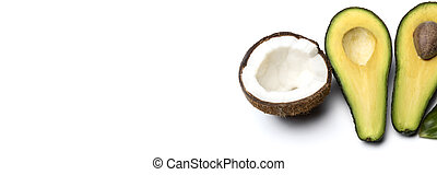 Isolated fruits. Half avocado and half coconut. Copy Space.