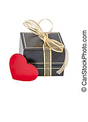Isolated gift box and red heart on white