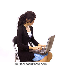 Isolated girl typing on laptop