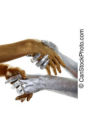 gold and silver hands