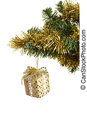 gold christmas gift on branch