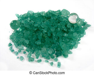 isolated green minerals on white background with a small crystal ball