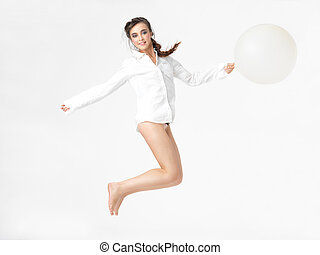 isolated happy woman jumping with balloon