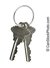Isolated house keys - Two house keys on keyring isolated...