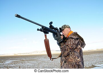 Isolated image of hunter with rifle