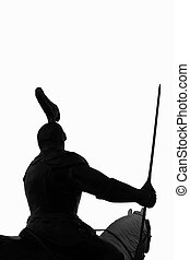 Isolated knight - Silhouette of a knight armed amd mounted...
