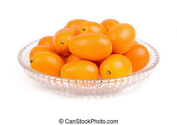 kumquat - isolated kumquat, The fruit has a sweet outer skin...