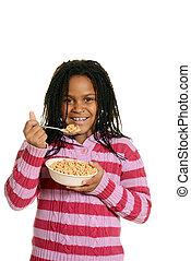 black girl enjoying bowl of cereal