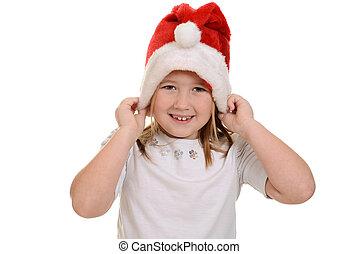little girl putting on santa hat