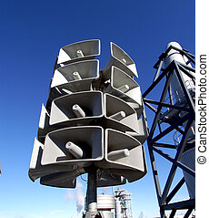Isolated loudspeakers with a natural blue background