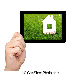 isolated man hand holding a tablet computer with green grass and a house on the screen