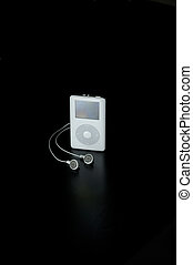 Isolated mp3 player. Black background.