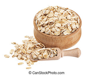 Isolated oat flakes. Wooden bowl and scoop with oatmeal on white background. Close-up