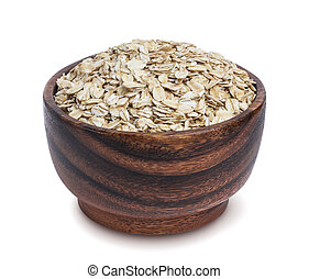 Isolated oatmeal. Oat flakes in wooden bowl on white background