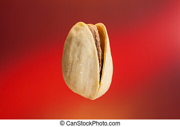 isolated pastachio on red background