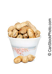 Peanuts with shells in a bowl