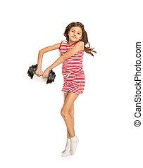 isolated photo of little girl lying on floor and lifting dumbbel