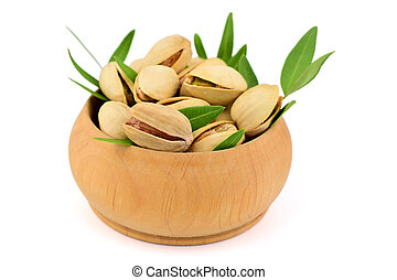 Isolated Pistachio Nuts in a Bowl.