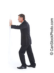 Isolated portrait of a senior business man pushing against the wall