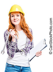 isolated portrait of a woman with tools in a yellow hard hat