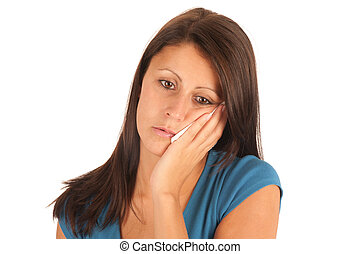 Isolated portrait of an attractive young woman suffering...