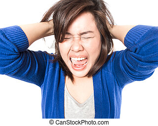 Isolated portrait of young stress woman going crazy pulling her hair in frustration on white background. Pretty female model angry.