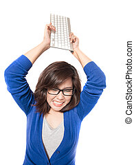 Isolated portrait of young stress woman with computer keyboard on white background. Pretty eyeglasses female model angry.