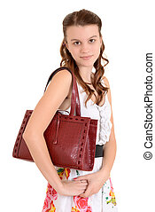 Portrait teen girl with a purse
