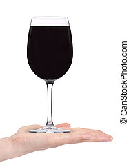 isolated red wine in a goblet with hand