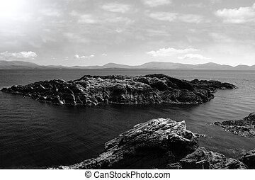 isolated rocky islands - scenic view in kerry ireland of...