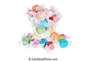 isolated salt water taffy in a bowl on white background