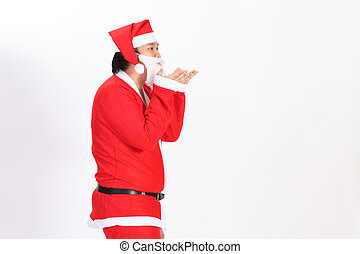 Isolated Santa blow something over white background