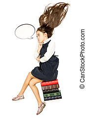 Isolated shot of thoughtful schoolgirl sitting on pile of books