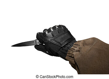 Isolated soldier arm holding tactical knife.
