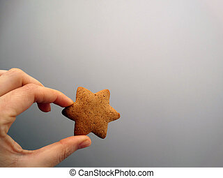 Isolated Star Cookie in a Hand