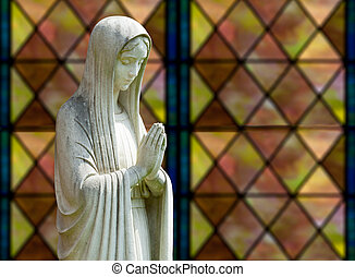 Isolated statue of Mary against window - Statue of Mary...