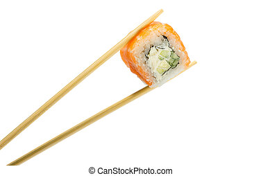 Isolated sushi roll in chopsticks. Macro.