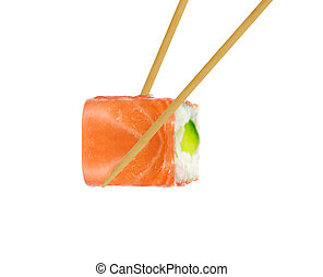 Isolated sushi roll in chopsticks