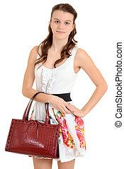 Teen girl holding a purse