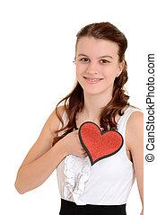 Teen girl holding glitter heart