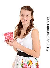 Teen girl holding valentines gift