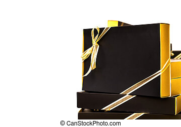 isolated tower Low cost and budgeting black and gold ribbon gift box in holiday season. Clipping Path