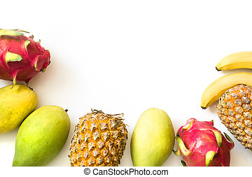Isolated tropical fruits. Pineapple, banana, dragon fruit and mango isolated on white. Top view.