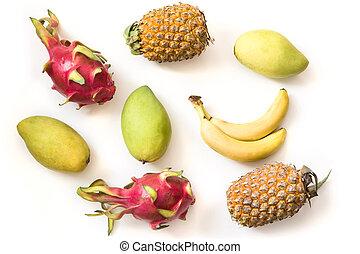Isolated tropical fruits. Pineapple, banana, pitaya fruit and mango isolated on white background.