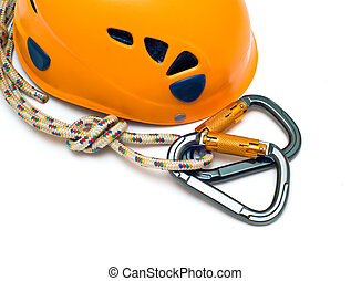 isolated two alpinism carabiners and orange helmet