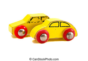 isolated two old wooden cars toys