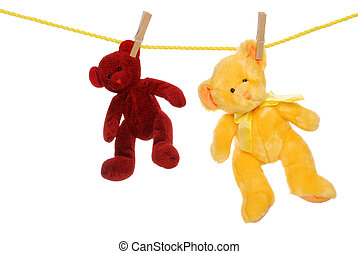 two teddy bears on clothes line